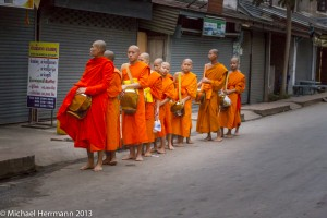 Ball Game and Monks taking and giving alms